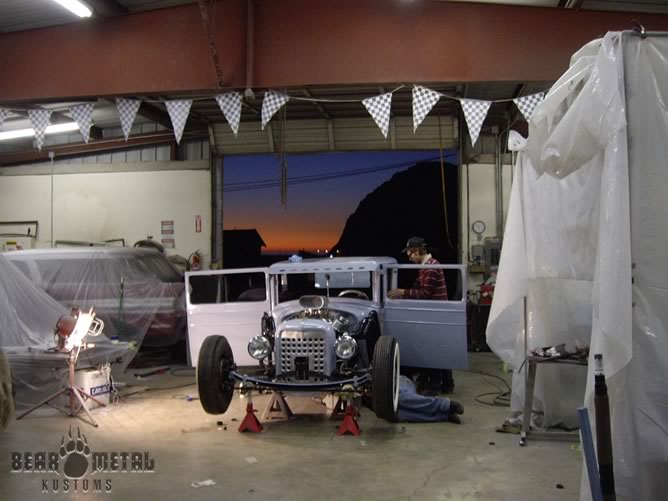 Working on the Chrysler with the Morro Bay sunset in the background