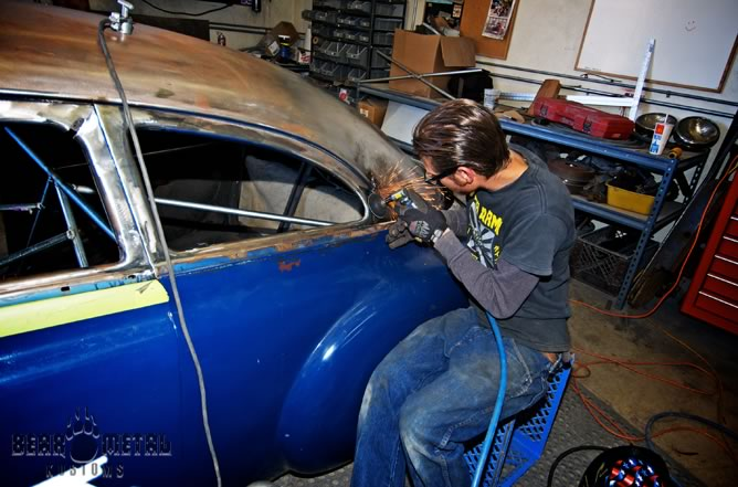Johnny at work on the Oldsmobile.